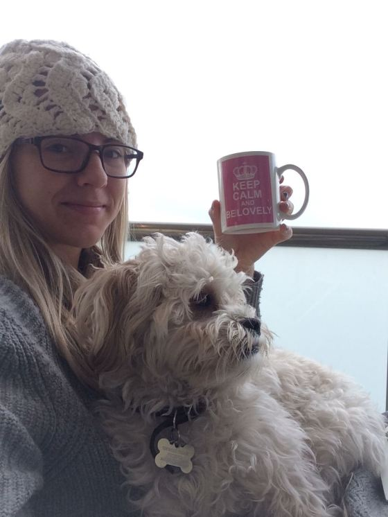 Ted and I enjoying a cup of coffee on the balcony in our new furniture with my Grandma Hat on.